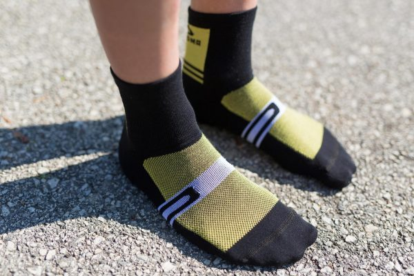 Front feet picture showing front structure of velocity blk yellow biking socks