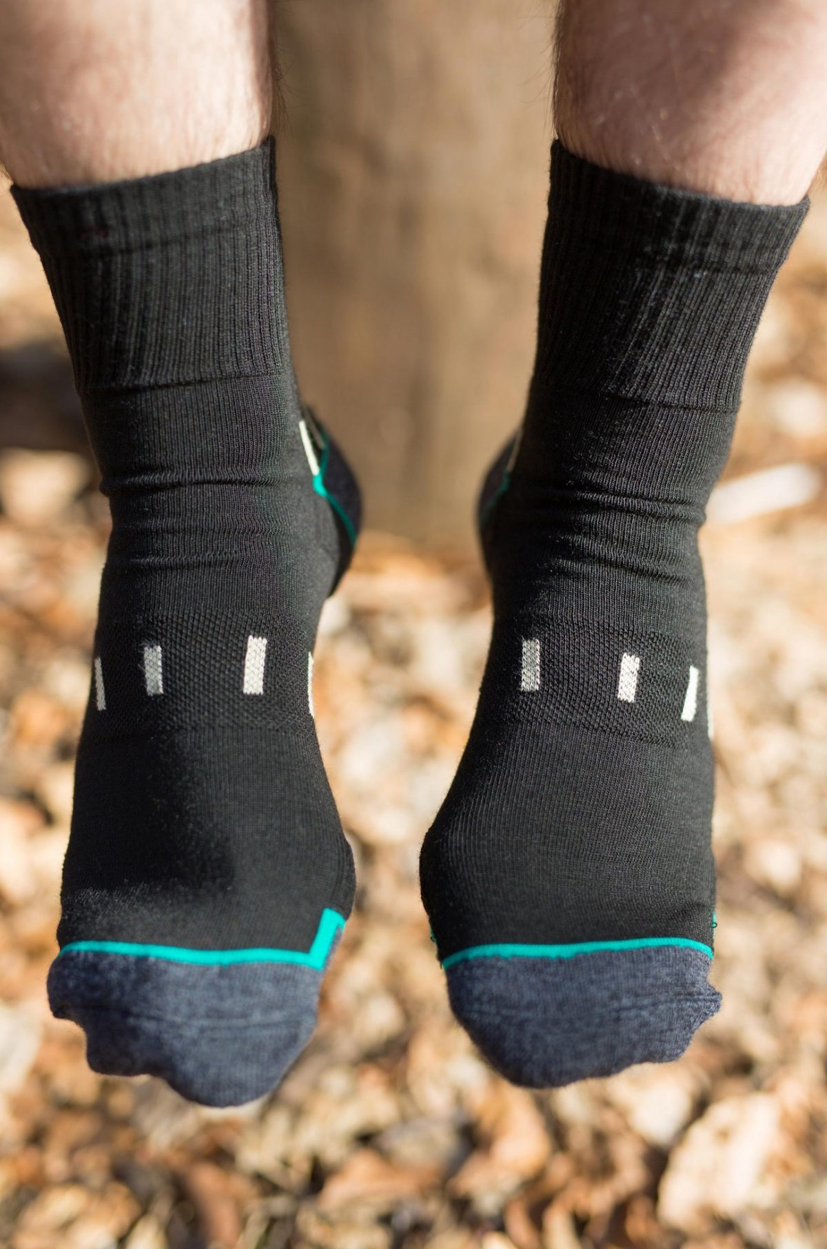Front feet picture of a man wearing dogma mountain goat hiking sock. Picture is taken in the woods