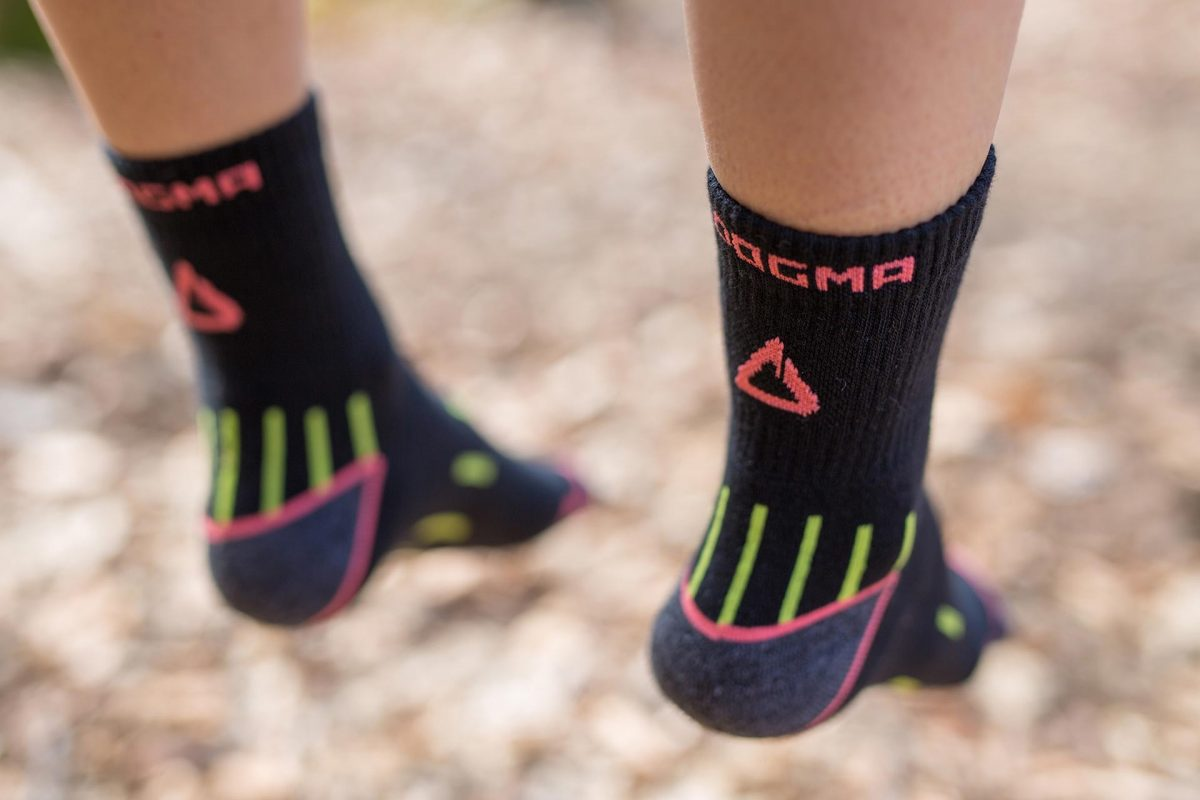 This picture is showing woman hiking socks named Mountain goat in black color