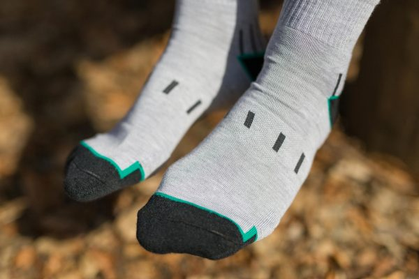 front feet picture of man dogma hiking mountain goat socks in grey showing front knit structre and design