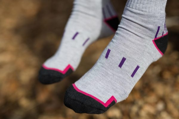 Dogma woman Mountaing goat socks showing front design in grey, black and purple and fuchsia stripes