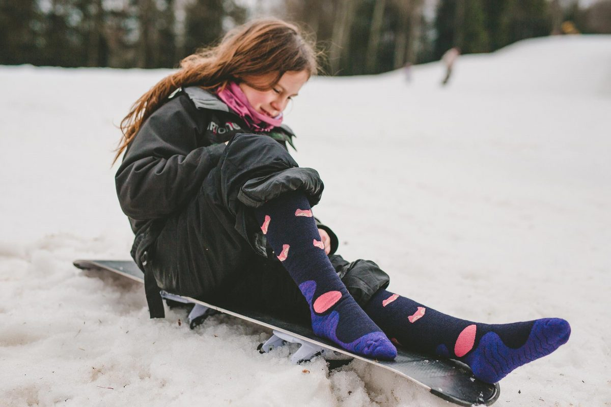 A picture of girl wearing snow fox junior socks