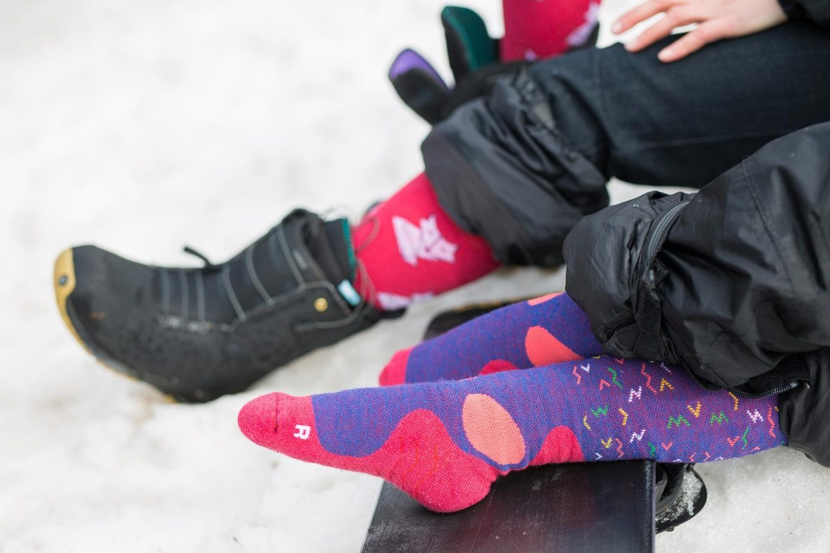 A picture of a girl and woman wearing dogma snow fox socks