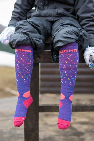 this is a picture of a girl showing off her snow fox socks with worms design in purple color