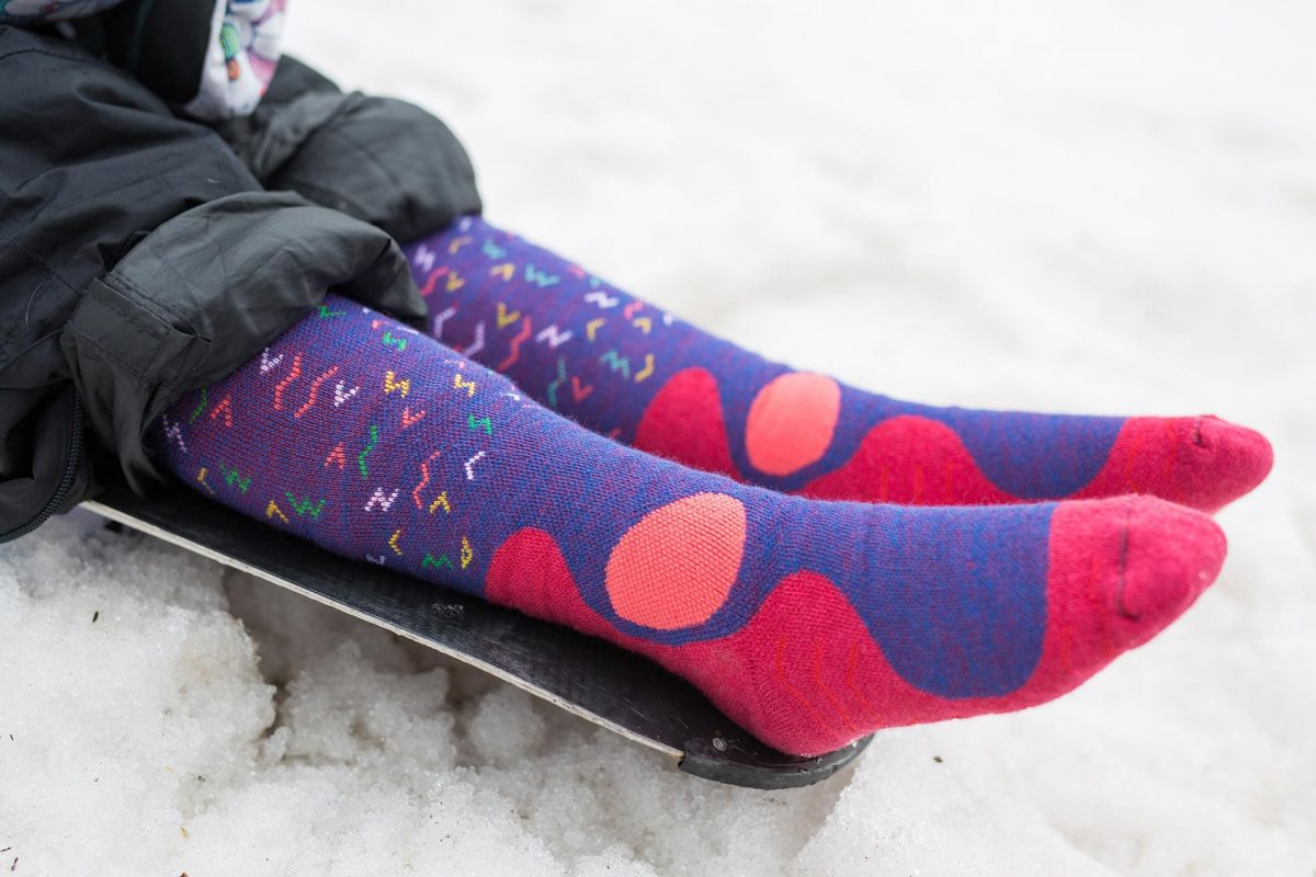 This picture is showing design of snow fox junior worms socks in purple color