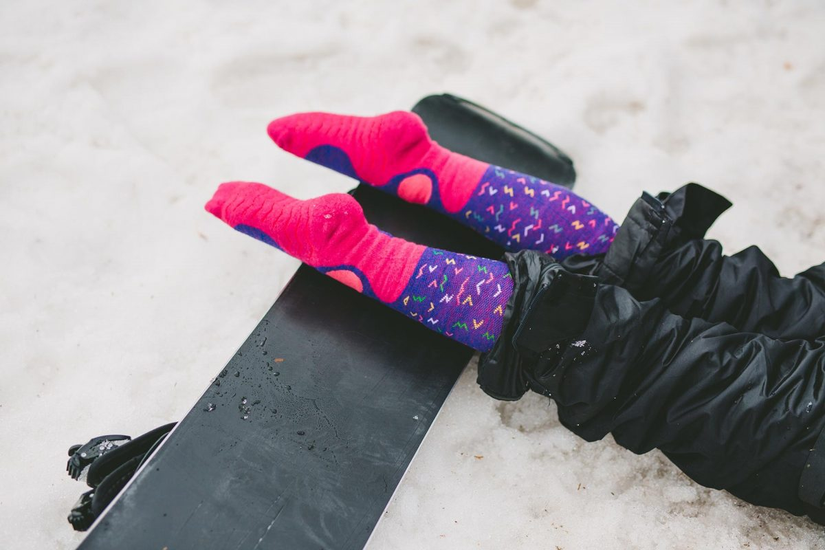 A picture of girl showing feet structure of snow fox junior worms socks design