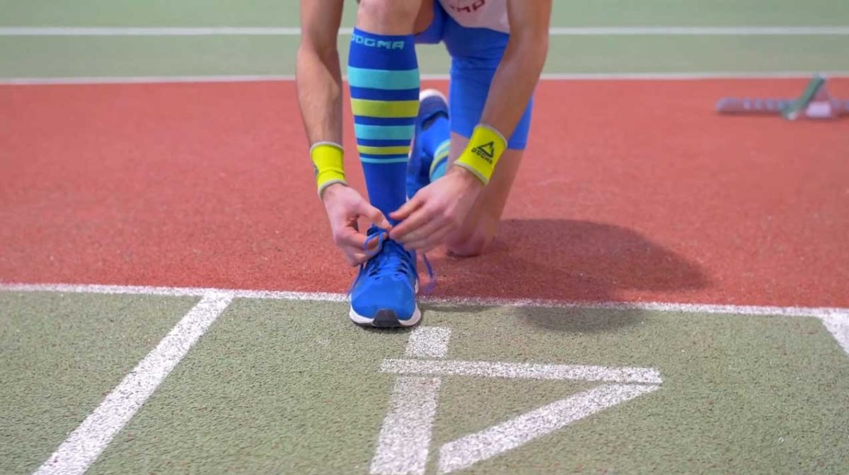 This is a picture of men running sock named The Gazelle, knee height. Color is named Indigo stripe. It comes in indigo blue color with baby blue and lime stripes.