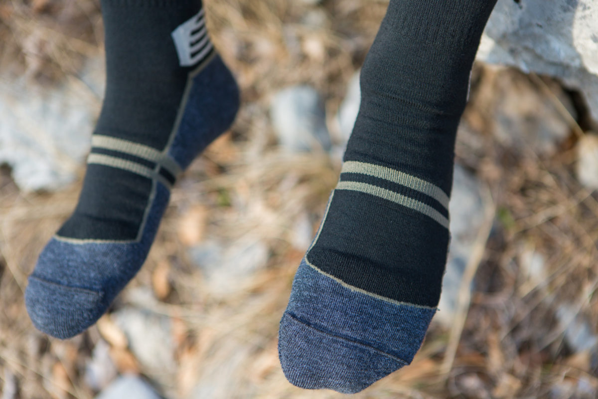 Close up picture of Dogma Yeti Black hiking socks for men showing front feet design and structure