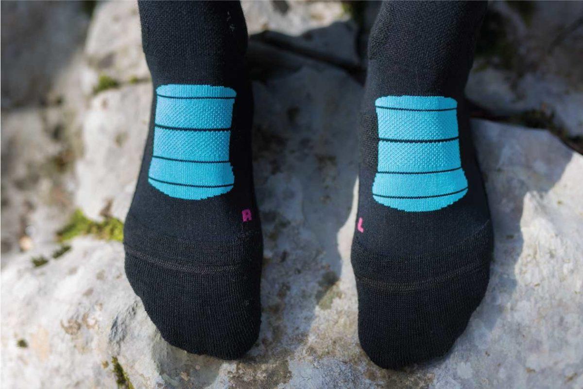Dogmasocks Snow Eater winter socks for women. Front feet design with baby blue stiripes
