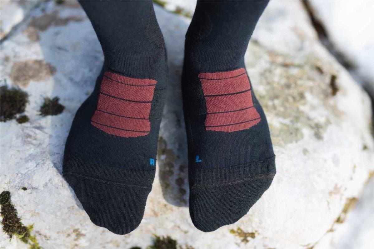 Dogmasocks Snow Eater winter socks for men with burgundy stripes.