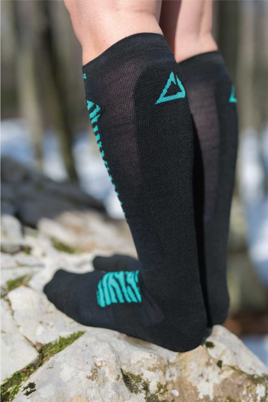Dogmasocks Snow Eater winter socks for women. with mint tiger design. Back side in black with mint Dogma logo