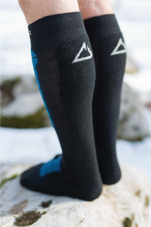 Dogmasocks Snow Eater winter socks for men with petrol stripes. Back side design in black with white Dogma logo