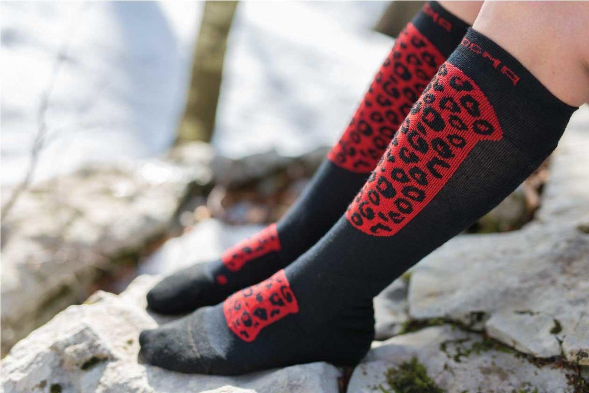 Dogmasocks Snow Eater winter socks for women. with Red Leopard design. Side design