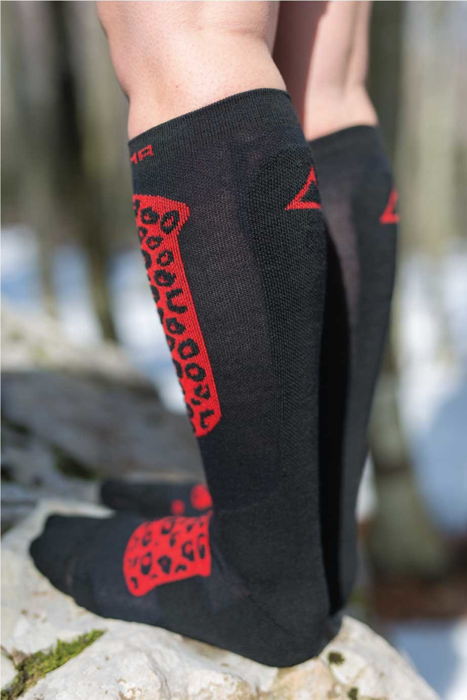 Dogmasocks Snow Eater winter socks for women. with Red Leopard design. Back side in black with red Dogma logo