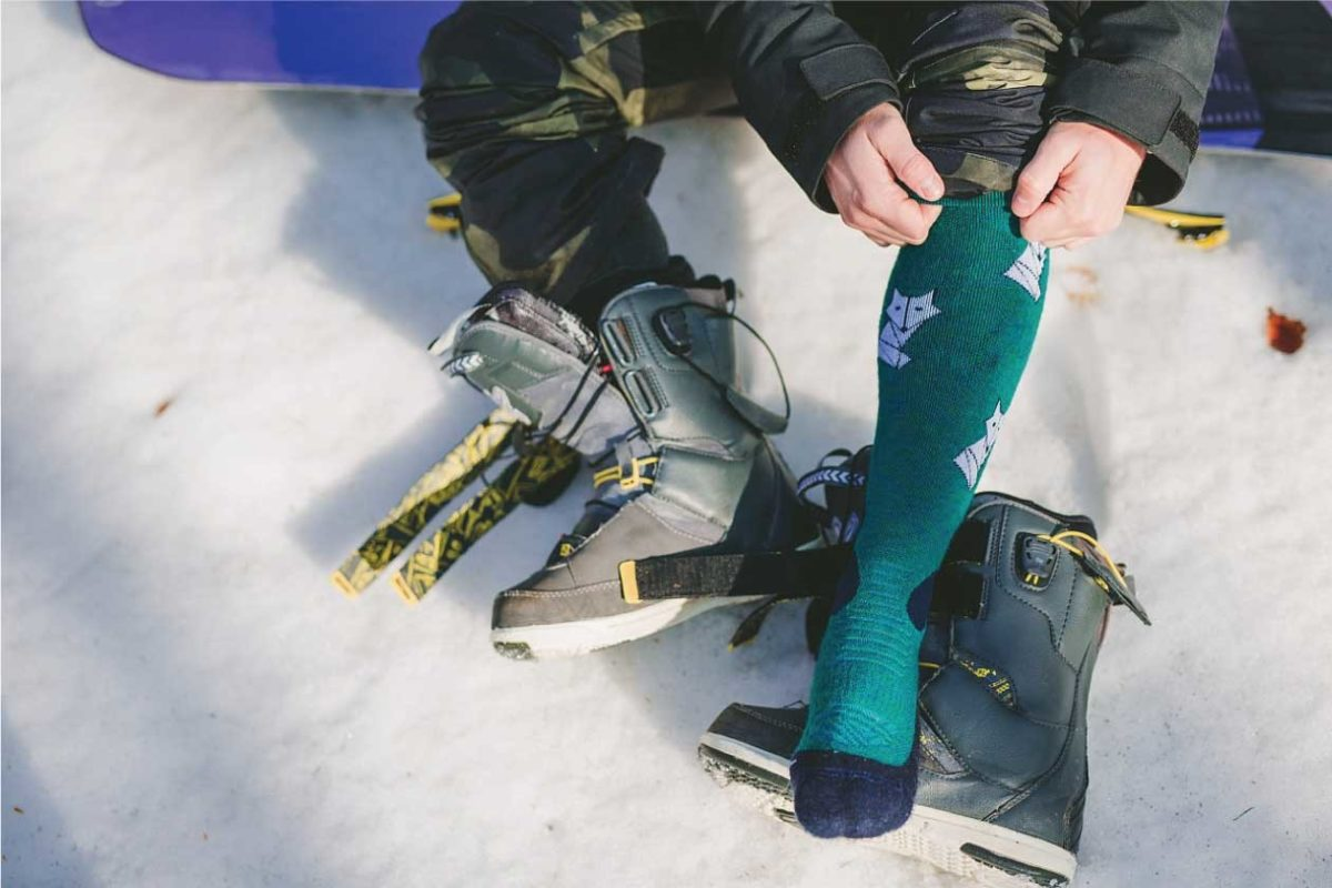 Dogmasocks snow snow fox foxy teal men winter socks. A picture of a men wearing dogma snow fox socks, knee height