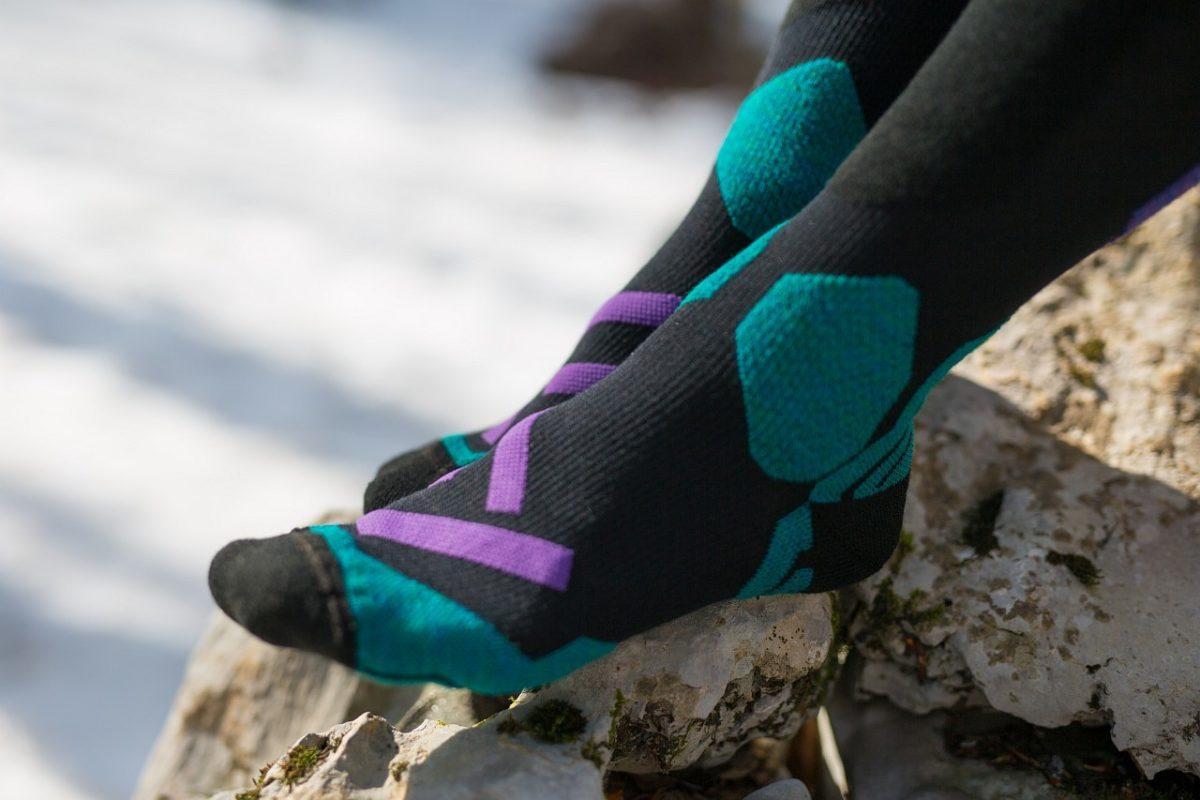 Dogmasocks snow snow leopard socks shield purple toe design