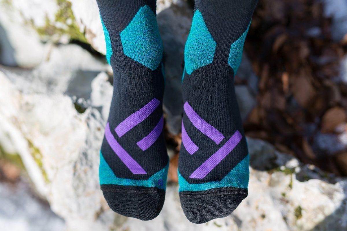 Dogmasocks snow snow leopard socks shield purple front feet design