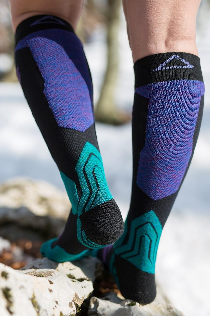 Dogmasocks snow snow leopard socks shield purple back side design