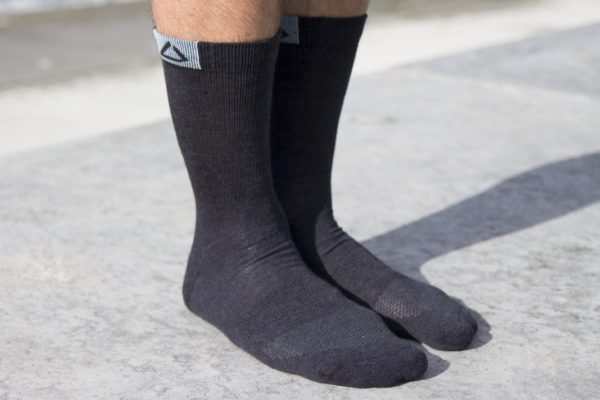 Travel socks in black melange color with Dogma logo