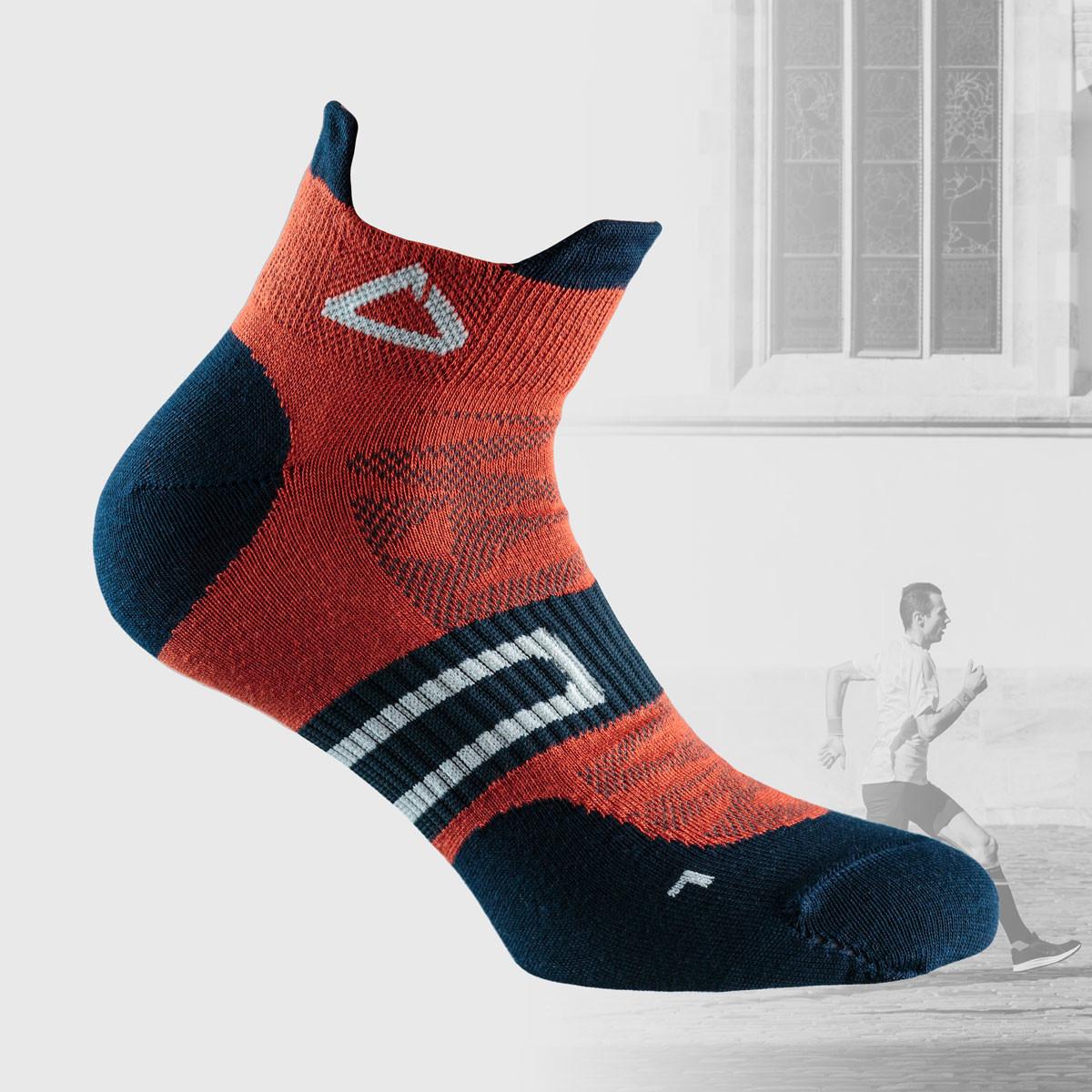 Orange running socks with dark blue details