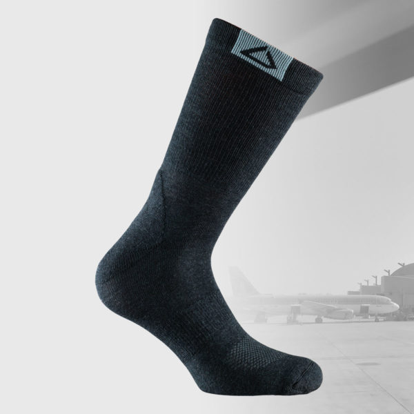 travel socks in black color with small grey logo